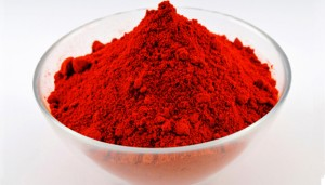 Red paprika powder in a round glass